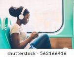 young black woman listening... | Shutterstock . vector #562166416