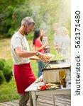 a gray haired man preparing a... | Shutterstock . vector #562171480