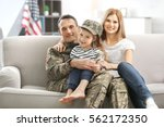 soldier in camouflage and his... | Shutterstock . vector #562172350
