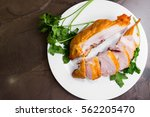 smoked chicken breast on a... | Shutterstock . vector #562205470