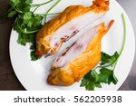 smoked chicken breast on a... | Shutterstock . vector #562205938