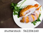 smoked chicken breast on a... | Shutterstock . vector #562206160