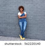 full length portrait of smiling ... | Shutterstock . vector #562220140