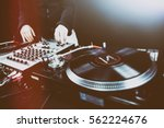 club dj playing mixing music on ... | Shutterstock . vector #562224676