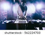 club dj playing mixing music on ... | Shutterstock . vector #562224703