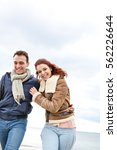 beautiful young tourist couple... | Shutterstock . vector #562226644