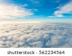 sunrise above clouds from... | Shutterstock . vector #562234564