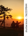 silhouette of couple with sunset | Shutterstock . vector #562239844