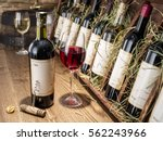 glass of wine and wine bottle.... | Shutterstock . vector #562243966