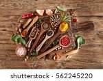 herbs and spices  on a wooden... | Shutterstock . vector #562245220
