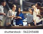 crew of designers looking at... | Shutterstock . vector #562245688