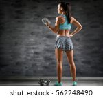 sporty young woman with... | Shutterstock . vector #562248490