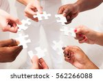 multi ethnic young adults' hands | Shutterstock . vector #562266088
