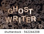 Small photo of Ghostwriter text in wooden letters floating above random letters out of focus