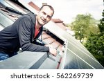 home owner is happy with solar... | Shutterstock . vector #562269739
