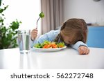 small girl refusing to eat... | Shutterstock . vector #562272748