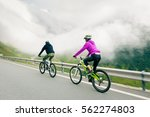 young couple cycling | Shutterstock . vector #562274803