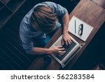 top view of young busy worker... | Shutterstock . vector #562283584