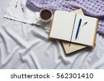 notepad letter cup of coffee... | Shutterstock . vector #562301410