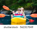 happy family with two kids... | Shutterstock . vector #562317049