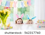 boy and girl in bunny ears at... | Shutterstock . vector #562317760