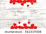 red hearts on rustic wooden... | Shutterstock . vector #562319308