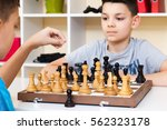 children playing chess at the... | Shutterstock . vector #562323178