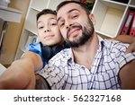 selfie son and dad  the concept ... | Shutterstock . vector #562327168