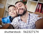 selfie son and dad  the concept ... | Shutterstock . vector #562327174