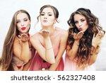 three happy beautiful brides... | Shutterstock . vector #562327408