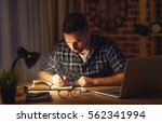 young man working on the... | Shutterstock . vector #562341994