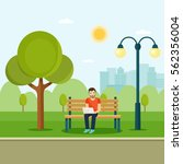 young man sitting in the park... | Shutterstock .eps vector #562356004
