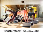 group of athletes working push... | Shutterstock . vector #562367380