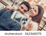 a happy couple having fun and... | Shutterstock . vector #562368370