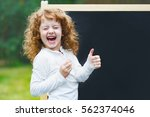 laughing little girl showing...   Shutterstock . vector #562374046