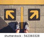 man standing arrow direction... | Shutterstock . vector #562383328