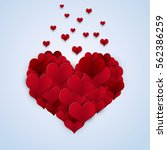 valentine day red heart shapes... | Shutterstock . vector #562386259