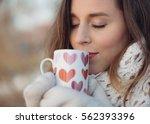 Winter Woman Holding A Mug To...