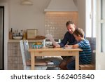 father helping son with... | Shutterstock . vector #562405840