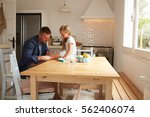 father putting sticking plaster ... | Shutterstock . vector #562406074