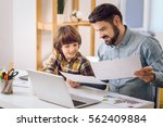 observation of picture father... | Shutterstock . vector #562409884