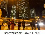 blurred light motion people... | Shutterstock . vector #562411408