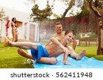 family having fun on water... | Shutterstock . vector #562411948