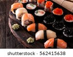 various kinds of sushi served... | Shutterstock . vector #562415638
