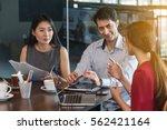3 people meeting in coffee shop ...   Shutterstock . vector #562421164