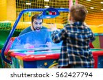 joyful bearded father and son... | Shutterstock . vector #562427794