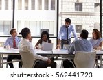 manager standing to address... | Shutterstock . vector #562441723