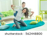 happy mom plays with her son at ... | Shutterstock . vector #562448800
