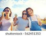 three girlfriends enjoying a... | Shutterstock . vector #562451353