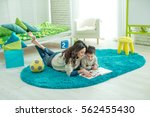 mom reads with a child | Shutterstock . vector #562455430